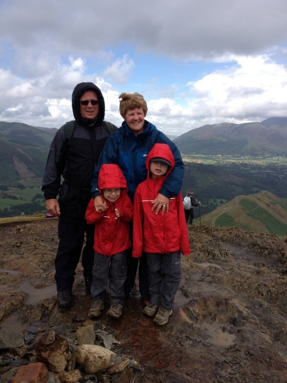 Nanny, Grandad and the two boys at the summit as a rain shower comes in!!