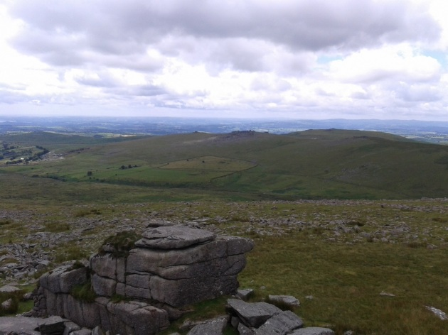From the summit of Great Mis Tor with views to the Staple Tors, Cox Tor and Cornwall beyond.
