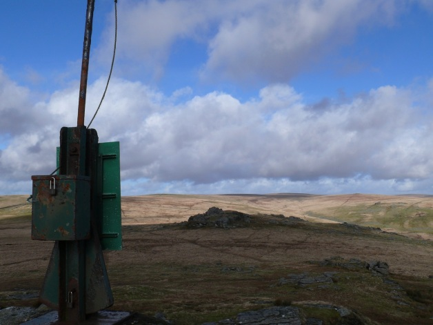 Flag post on Beardown tor, one of the other stacks in front with Crown and Rough Tor over on the right in the distance