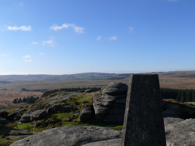 Bellever Tor trig point looking to Princetown in the distance