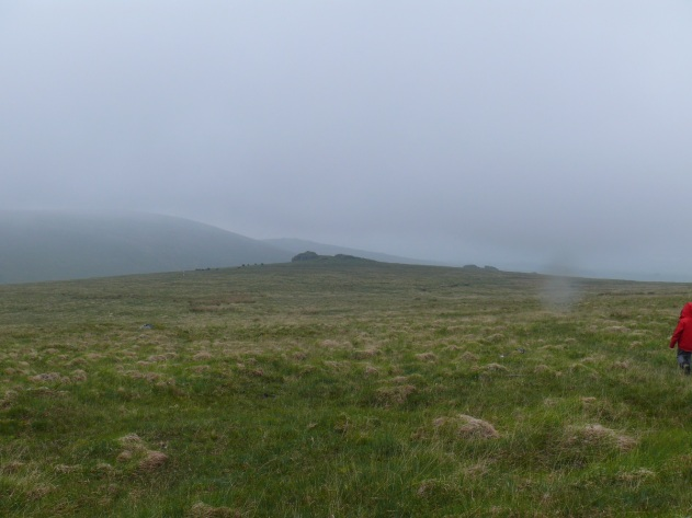 Heading down from High Willhays to Black Tor in the drizzle