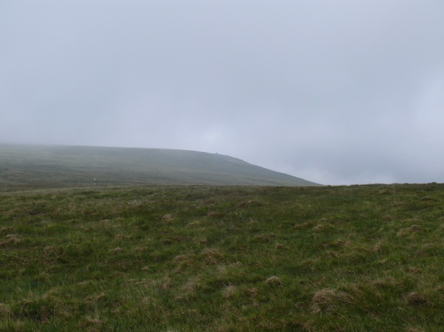 Looking back up to the cloud on High Willhays. Fordsland Lodge is the speck on the ridge