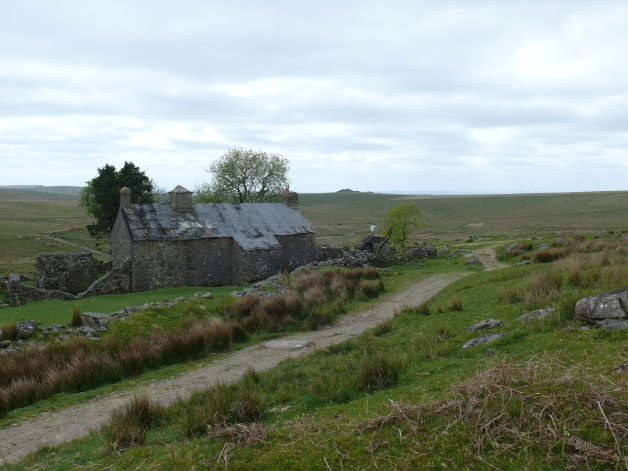 The back of Ditsworthy Warren House with Legis Tor in the distance