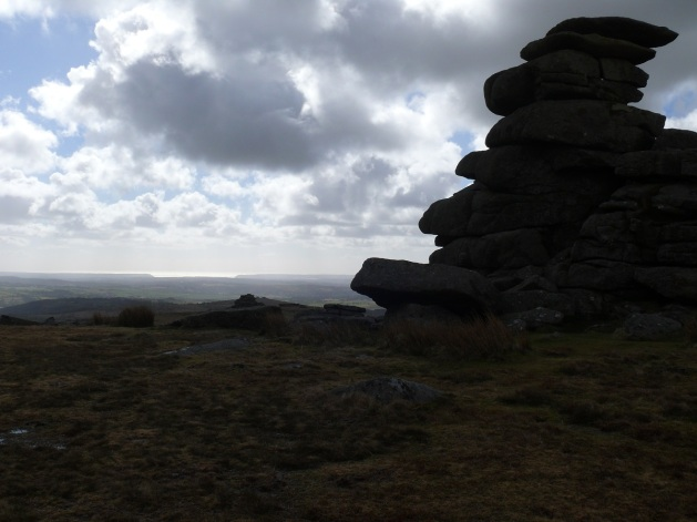 Granite stacks on Great Staple Tor with Plymouth Sound in the distance