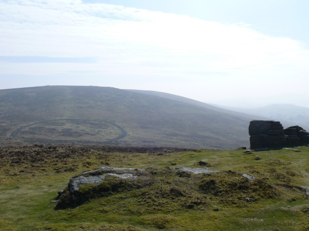 Looking down from Hookney Tor to Grimspound, Hameldown Tor rising up behind.