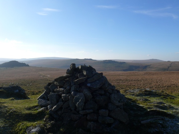 Cairn on Higher White Tor with Longaford Tor left, Beardown Tors over the cairn and Great Mis Tor right.