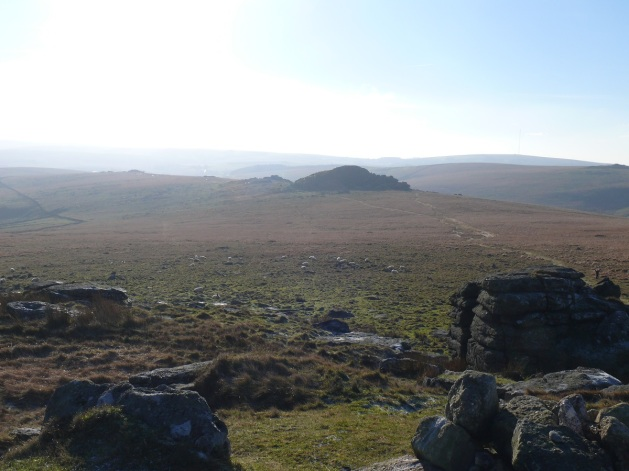 Looking back into the sun to Longaford Tor and Littaford Tor