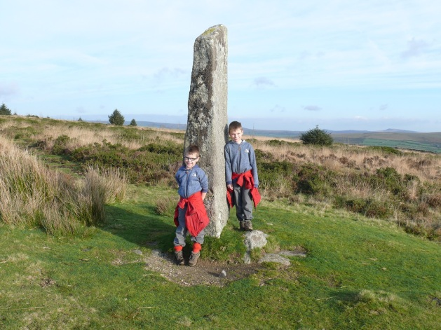 The boys by the standing stone (menhir) on Laughter Tor