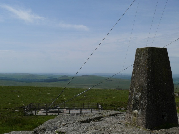 North Hessary Tor trig point looking beyond the mast cables to Sharpitor and Leather Tor in the middle distance with Plymouth Sound beyond