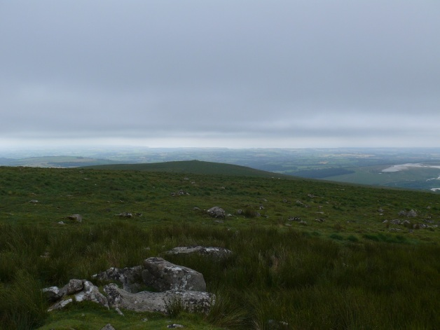 Looking from Shell Top down to Penn Beacon, even with the cloud South Hams is seen stretching out beyond