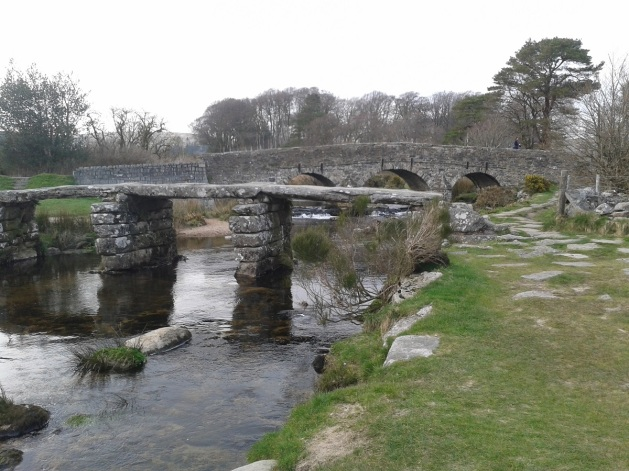 The clapper bridge and road bridge behind at Postbridge