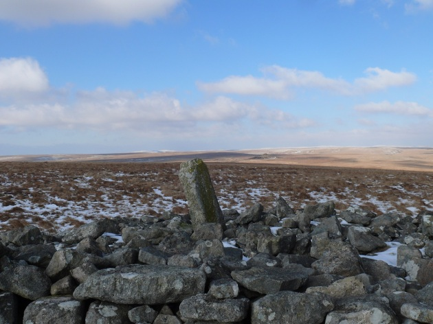 The stump of Petres Cross on Western White Barrow. Redlake just to the right of the cross