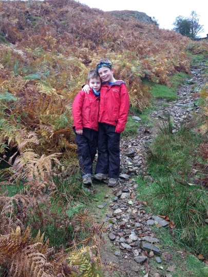 Wet weather gear on, climbing the path