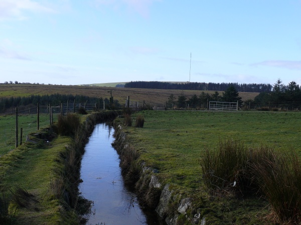 Above Beardown Farm we reach the Devonport Leat with good views back to the mast at Princetown