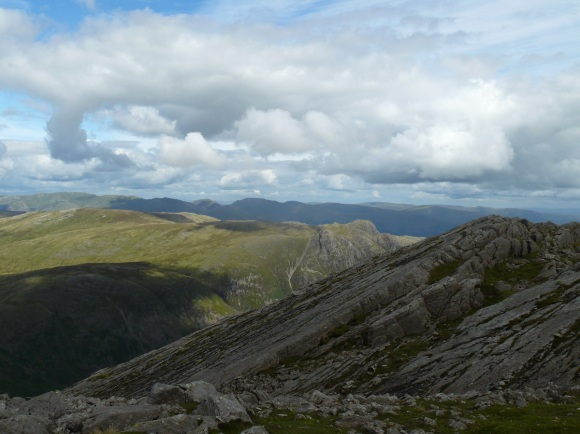 The Great Slab on Bowfell with the Langdale Pikes beyond.