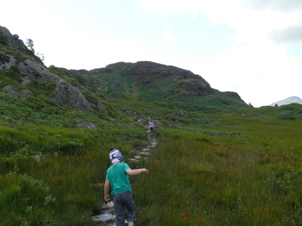 Heading across the stepping stones with Great Crag ahead
