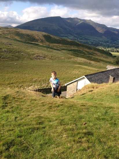 Climbing away from the church with Blencathra behind