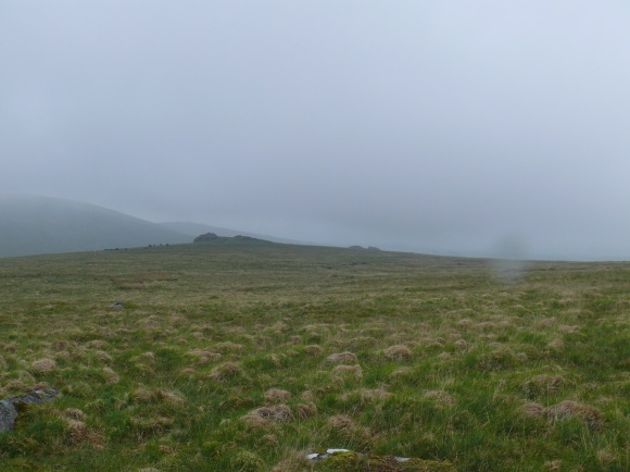 Looking down on Black Tor as we come out of the cloud