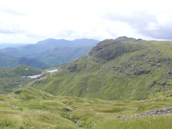 On the path to Sergeant Man, Pavey Ark on the right and a small part of Stickle Tarn