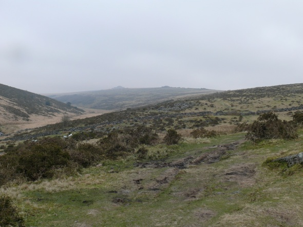 Climbing the side of Crocken Tor and looking at a rather gloomy Longaford Tor