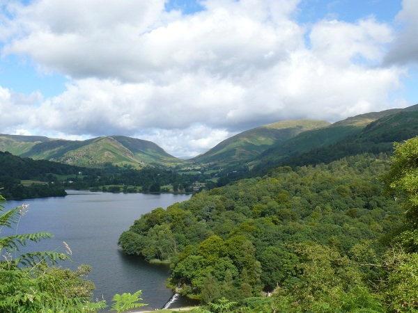 Along the length of Grasmere with Helm Crag the fell in the sun