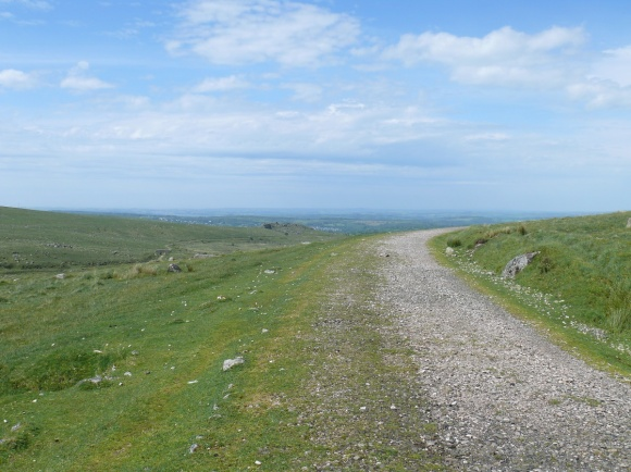 Looking back along the old railway path with Ingra Tor in the middle distance and Cornwall beyond
