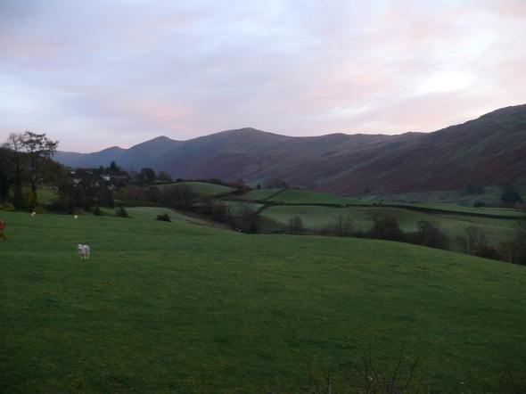 As the sun lights the Ill Bell ridge opposite