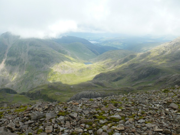 Sunshine lights up Styhead from the path up to Scafell Pike summit