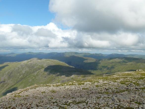 Over Allen Crags to the distant Helvellyn range.