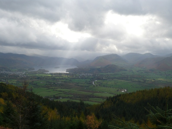 That doesn't look good, as sunlight pierces the clouds on Derwent Water