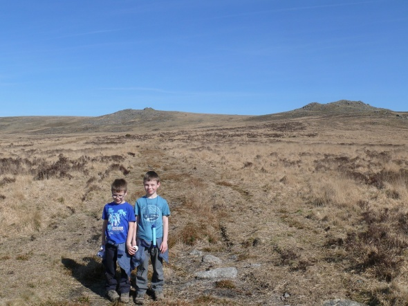 The boys with Sharp Tor left and Hare Tor right