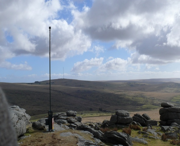 Roos Tor summit and military flag post with North Hessary Tor behind
