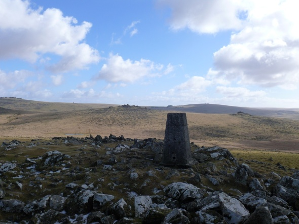 Cox Tor trig with the Staple tors in the middle distance and North Hessary Tor and the mast beyond
