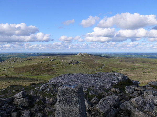 Trig point of Rippon Tor with Haytor behind
