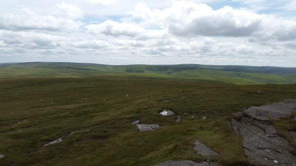 Looking down to the small bump the is Dinger Tor