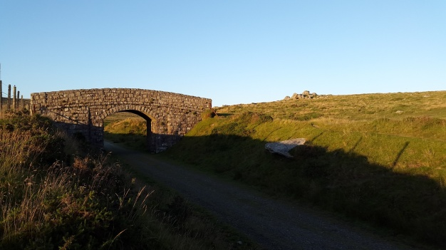 Princetown railway and a bridge with East Tor behind