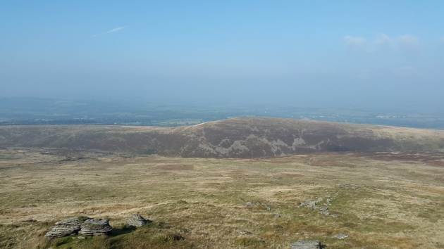 Hazy view to Cornwall with Great Nodden in the foreground